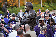 At 8-feet 6-inches, the statue of Don James unveiled outside Husky Stadium looms large above the crowd - just as James legend looms over Husky football.  (Dean Rutz / The Seattle Times)