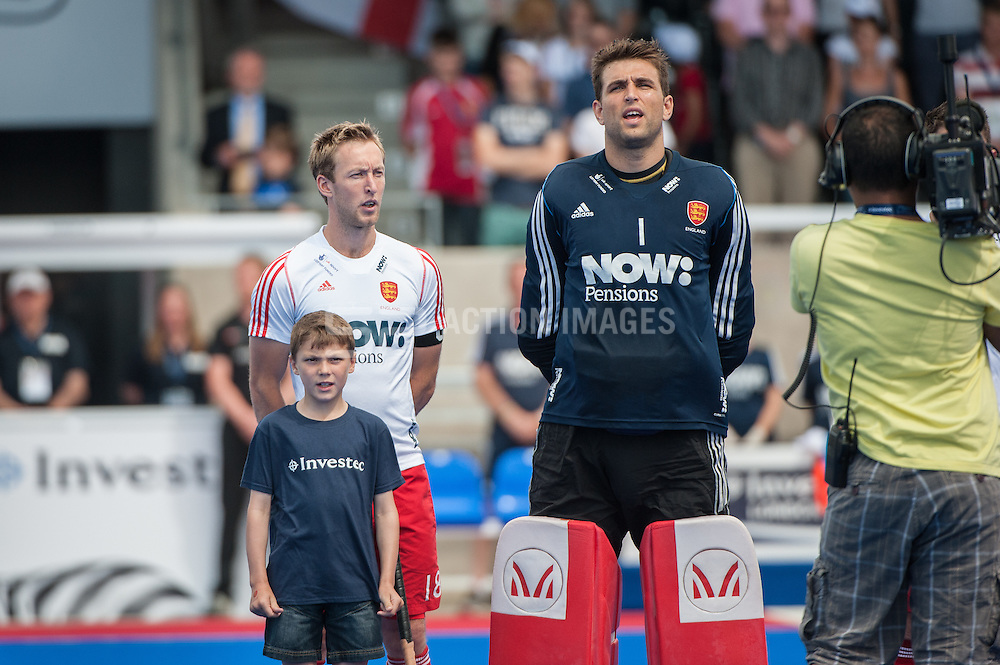 The English team sing the national anthem before the final of the Investec London Cup against Ireland. Lee Valley Hockey & Tennis Centre, London, UK on 13 July 2014. Photo: Simon Parker