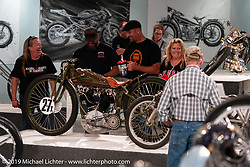 Checking out Mike Lange's 8-Valve 1927 Harley-Davidson Factory 1/2 Mile 8-valve racer in the What's the Skinny Exhibition (2019 iteration of the Motorcycles as Art annual series) at the Sturgis Buffalo Chip during the Sturgis Black Hills Motorcycle Rally. SD, USA. Thursday, August 8, 2019. Photography ©2019 Michael Lichter.