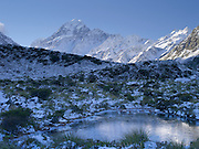 A frozen tarn sits in front of Aoraki on a cool winter day; Aoraki/Mt. Cook National Park, New Zealand