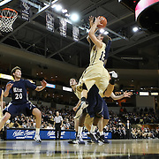 Central Florida guard Taylor Young (12) drives to the hoop during a Conference USA NCAA basketball game between the Rice Owls and the Central Florida Knights at the UCF Arena on January 22, 2011 in Orlando, Florida. Rice won the game 57-50 and extended the Knights losing streak to 4 games.  (AP Photo/Alex Menendez)