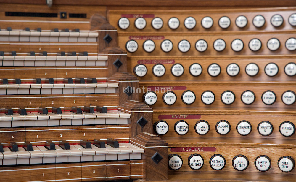 close up of an wooden organ keyboard with the pulls and stops  JL van den heuvel builder