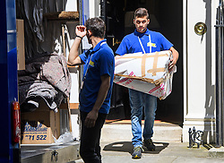 © Licensed to London News Pictures. 16/07/2016. London, UK. Items being placed in a van for David Cameron. Removal men begin to take items from numbers 10 and 11 at Downing Street at the end of the week that saw Prime Minister David Cameron leave and Theresa May arrive. Photo credit: Ben Cawthra/LNP