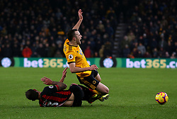 Bournemouth's Steve Cook tackles Wolverhampton Wanderers' Diogo Jota during the Premier League match at Molineux, Wolverhampton.
