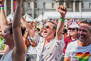 The crowd, in Trafalgar Square, responds as they hear England have gone one nil up  - The London Pride parade and event in Trafalgar Square.