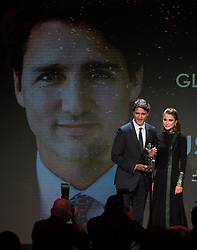 Queen Rania of Jordan presents Canadian Prime Minister Justin Trudeau with an award before he speaks at the Atlantic Council Global Citizen Awards Gala dinner at the Intrepid Sea, Air & Space Museum in New York City, NY, USA, Tuesday September 19, 2017. Photo by Adrian Wyld/CP/ABACAPRESS.COM