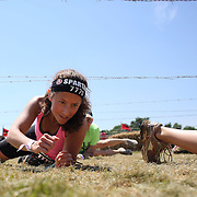 Rebecca Fox in action at the barbed wire crawl obstacle during the Reebok Spartan Race. Mohegan Sun, Uncasville, Connecticut, USA. 28th June 2014. Photo Tim Clayton