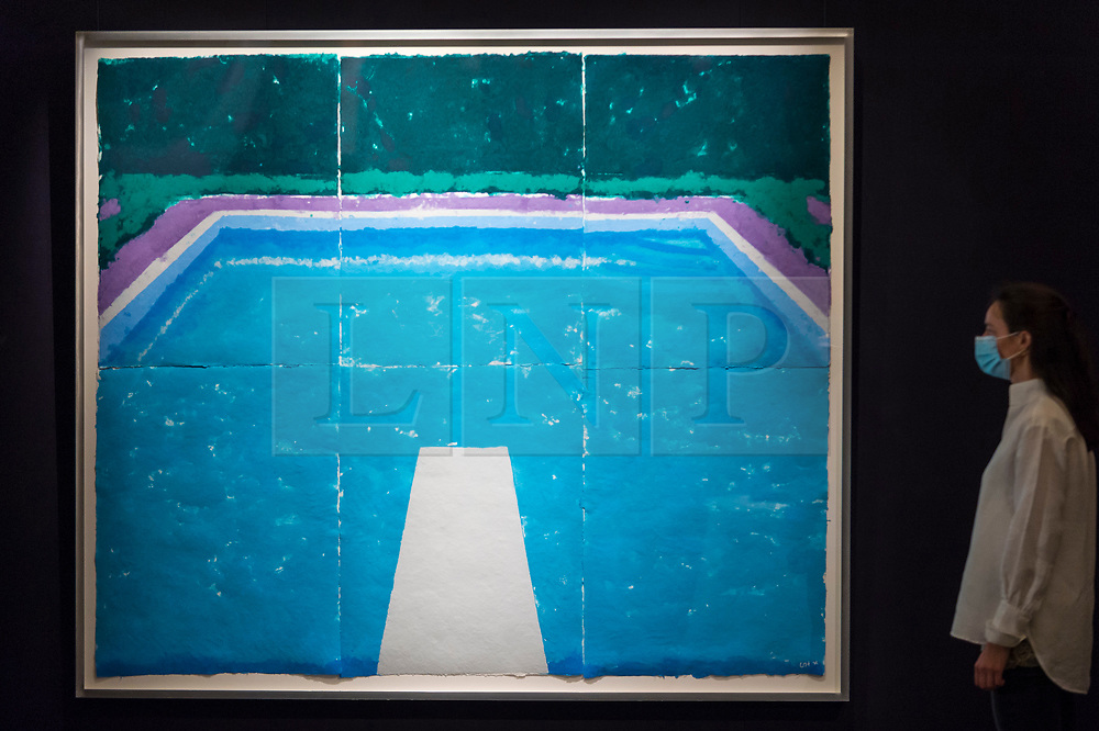 """© Licensed to London News Pictures. 23/07/2020. LONDON, UK. A staff member next to """"Pool on a Cloudy Day with Rain (Paper Pool 22) (1978) by David Hockney, estimate: £4-6 million. Preview of works on display at Sotheby's London ahead of a one-off auction on July 28.  Titled 'Rembrandt to Richter', the sale will offer the very best from Old Masters, Impressionist & Modern Art, Modern & Post-War British Art and Contemporary Art.  The exhibition is open to the public at Sotheby's New Bond Street galleries until July 28. [Image embargoed for release until 9am BST 24 July 2020].  Photo credit: Stephen Chung/LNP"""
