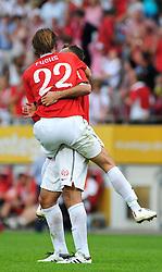 22.08.2010, Bruchwegstadion, Mainz, GER, 1. FBL, FSV Mainz 05 vs VfB Stuttgart, im Bild nach dem Spiel: Christian FUCHS (Mainz AUT #22) und Nikolce NOVESKI (Mainz MKD #4) springen  sich um den Hals, EXPA Pictures © 2010, PhotoCredit: EXPA/ nph/  Roth+++++ ATTENTION - OUT OF GER +++++ / SPORTIDA PHOTO AGENCY