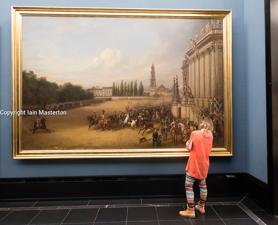 """Woman looking at painting """"Presentation of the Regiment in Potsdam 1817"""" by Franz Kruger at Alte Nationalgalerie on Museumsinsel, Berlin, Germany"""