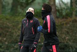Arsenals' Hector Bellerin (left) and Alex Iwobi (right) during the training session at London Colney, Hertfordshire.