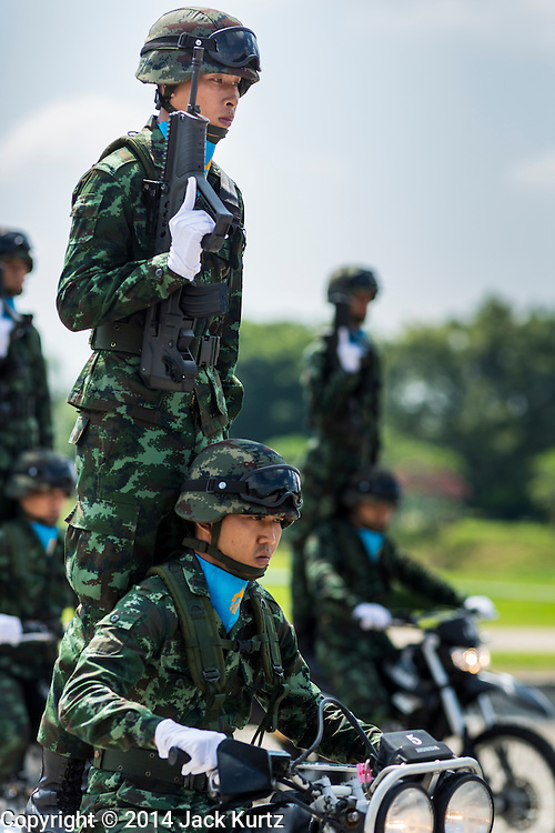 29 SEPTEMBER 2014 - NAKHON NAYOK, NAKHON NAYOK, THAILAND: Members of a Thai army motorcycle drill team performs at the retirement ceremony for more than 200 Thai generals including Gen. Prayuth Chan-ocha, who led the 22 May coup against the civilian government earlier this year. Prayuth has been chief of the Thai army since 2010. After his retirement, Gen. Prayuth will retain his posts as head of the junta's National Council for Peace and Order (NCPO) and Prime Minister of Thailand. Under Thai law, military officers must retire at 60 years of age. The 200 generals who retired with Prayuth were also his classmates at the Chulalomklao Royal Military Academy in Nakhon Nayok.    PHOTO BY JACK KURTZ