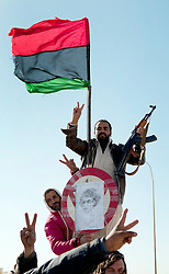 © under license to London News Pictures. 23/02/2011. Memebers of the opposition pose in front of the pre 1969 Libyan Flag at the border with Egypt. Photo credit should read Michael Graae/London News Pictures