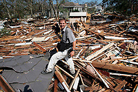 Jack Gruber walking through ruble after riding out Hurricane Katrina in Gulfport, Mississippi in the Holiday Inn On The Beach 2005.