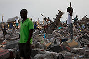 Demolitions continued on Thursday, May 21, 2020, to make way for the construction of a multi-million dollar fishing harbour in Jamestown, Ghana, with funds granted by the Chinese government. Work is expected to commence immediately after the Accra Metropolitan Assembly, clears out the area. Some displaced residents however feel that the exercise could have waited till the spread of the coronavirus disease (COVID-19) was under control. <br /> -<br /> Jamestown, Ghana. May 21, 2020. Photos: Francis Kokoroko