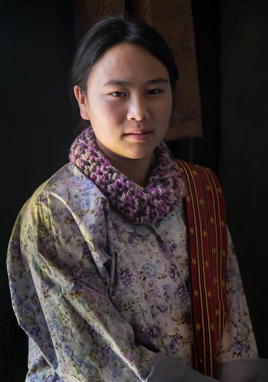 PARO, BHUTAN - CIRCA OCTOBER 2014: Portrait of young Bhutanese woman looking at camera in Bhutan