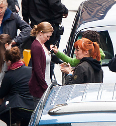 "Brad Pitt's co-star Mireille Enos the set of the movie ""World War Z"" being shot in the city centre of Glasgow. The film, which is set in Philadelphia, is being shot in various parts of Glasgow, transforming it to shoot the post apocalyptic zombie film."