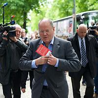 DEU, Deutschland, Germany, Berlin, 03.06.2013:<br />Start der Juso-Wahlkampftour vor dem Willy-Brandt-Haus. Hier Kanzlerkandidat Peer Steinbrück (SPD) während er eine SPD-Broschüre in sein Jacket steckt.