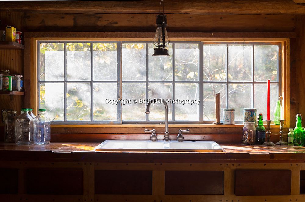 Interior of the kitchen sink at the home of Robert Runyon in Sugar Tree Hollow in Winslow, Arkansas, for Out Here Magazine. Photo by Beth Hall