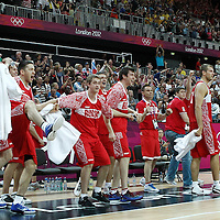 02 August 2012: Russia bench players celebrate at the end of 75-74 Team Russia victory over Team Brazil, during the men's basketball preliminary, at the Basketball Arena, in London, Great Britain.