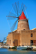 Ettore Infesera windmill, Masala Sicily. travel stock photos Mulino d'Infersa (mill of Infersa) wind mill, Ettore saltworks,  Saline della Laguna, Masala, Sicily. .<br /> <br /> Visit our SICILY PHOTO COLLECTIONS for more   photos  to download or buy as prints https://funkystock.photoshelter.com/gallery-collection/2b-Pictures-Images-of-Sicily-Photos-of-Sicilian-Historic-Landmark-Sites/C0000qAkj8TXCzro<br /> If you prefer to buy from our ALAMY PHOTO LIBRARY  Collection visit : https://www.alamy.com/portfolio/paul-williams-funkystock/trapanimaslalasaltpans.html .<br /> <br /> Visit our SICILY HISTORIC PLACES PHOTO COLLECTIONS for more   photos  to download or buy as prints https://funkystock.photoshelter.com/gallery-collection/2b-Pictures-Images-of-Sicily-Photos-of-Sicilian-Historic-Landmark-Sites/C0000qAkj8TXCzro<br /> .<br /> <br /> Visit our EARLY MODERN ERA HISTORICAL PLACES PHOTO COLLECTIONS for more photos to buy as wall art prints https://funkystock.photoshelter.com/gallery-collection/Modern-Era-Historic-Places-Art-Artefact-Antiquities-Picture-Images-of/C00002pOjgcLacqI