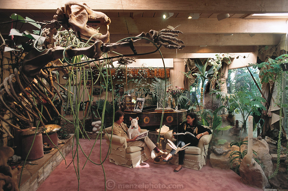 Arnold Newman and wife, Arlene, with fossil of a cave bear in their living room, Sherman Oaks, California. (1991)