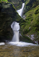 St. Nectans glen is an area of woodland in Trethevy near Tintagel, north Cornwall stretching for around one mile along both banks of the Trevillet River. The glen's most prominent feature is St Nectan's Kieve, a sixty foot waterfall through a hole in the rocks. T