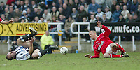 Photo. Andrew Unwin.<br /> Newcastle United v Charlton Athletic, FA Barclaycard Premier League, St James Park, Newcastle upon Tyne 20/03/2004.<br /> Newcastle's Alan Shearer (l) feels the pain after a challenge from Charlton's Chris Perry (r).