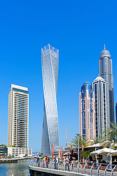 Skyscrapers and promenade at Marina district in Dubai United Arab Emirates