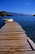 Jetty and white boat, Gemiler beach, Fethiye, Turkey