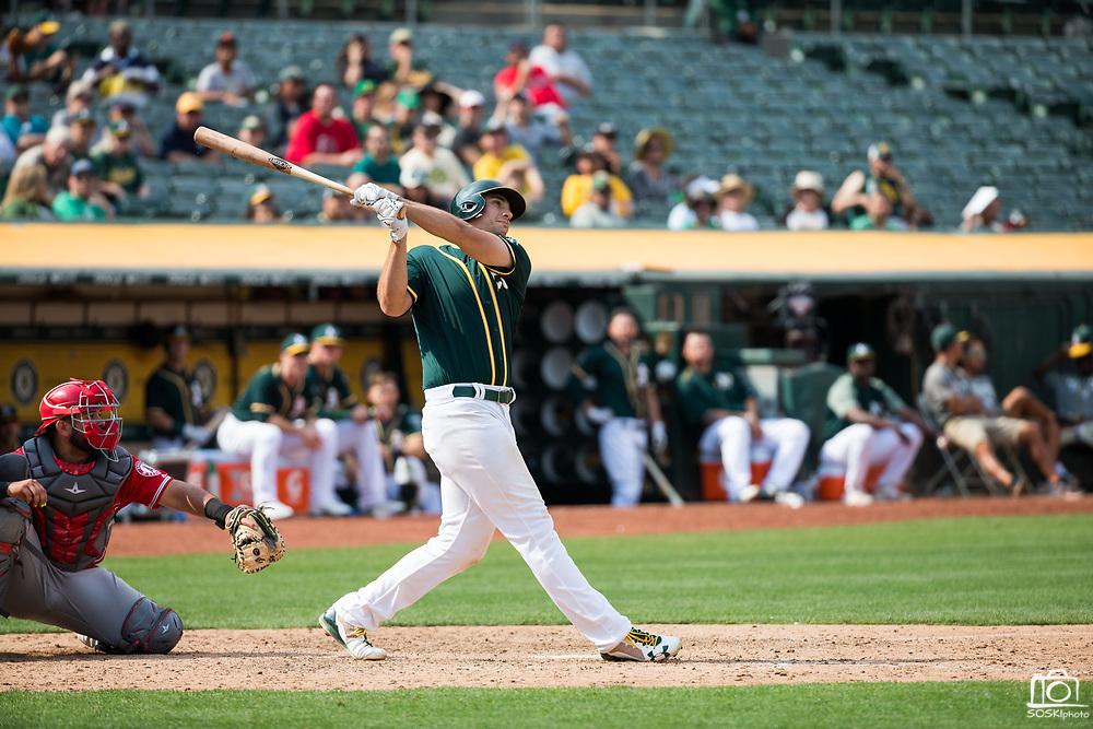 Oakland Athletics first baseman Matt Olson (28) bats against the Los Angeles Angels at Oakland Coliseum in Oakland, California, on September 6, 2017. (Stan Olszewski/Special to S.F. Examiner)