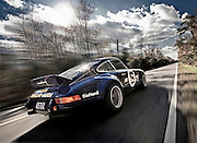 Automotive Car Photographer and Videographer Randy Wells, Image of a 1973 Sunoco RSR tribute car on a road in Virginia, Porsche 911 RSR, property released