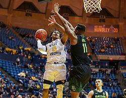 Jan 21, 2019; Morgantown, WV, USA; West Virginia Mountaineers guard Trey Doomes (0) shoots during the second half against the Baylor Bears at WVU Coliseum. Mandatory Credit: Ben Queen-USA TODAY Sports