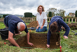 © Licensed to London News Pictures. 13/10/2018. Winchcombe, Gloucestershire, UK. Sudeley Castle. Historical novelist Dr PHILIPPA GREGORY watches archaeologists Jean Libre and Harriet Tatton, part of a team from DigVentures who hope to unearth a long-lost Tudor garden at Sudeley Castle this weekend. Philippa, who's well-known works include The Other Boleyn Girl and The White Queen, started her research into Sudeley Castle whilst working on a novel about Katherine Parr. For nearly 1,000 years, Sudeley Castle has hosted some of England's most famous monarchs including Henry VIII. It is also where Katherine Parr, Henry's last wife, later lived and was finally laid to rest. A recent geophysical survey at Sudeley revealed the ghostly outline of a long-lost Tudor garden, with traces of what could have been a banqueting house in the same area where pieces of Tudor masonry were found in the 19th century. Now experts say it is time to investigate further. The dig will take place at this Saturday and Sunday, October 13 and 14, and is thought to be the most significant archaeological investigation since the discovery of Roman villas on the estate in Victorian times. A specialist team from social archaeology company, DigVentures, will begin an investigation of the site, which aims to 'ground-truth' the geophysics results. They hope to reveal some of the Tudor secrets that remain hidden underground at the castle. Following the popular landscaping movement inspired by Capability Brown, many Tudor gardens were lost, and this is perhaps just one of only two in England where the original paths remain visible. Photo credit: Simon Chapman/LNP