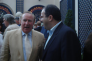 Andrew Neil and Stelios Haji-Ioannou. The Business Summer party hosted by Andrew Neil. Italian Hotel, Ritz Hotel. 12 July 2005. ONE TIME USE ONLY - DO NOT ARCHIVE  © Copyright Photograph by Dafydd Jones 66 Stockwell Park Rd. London SW9 0DA Tel 020 7733 0108 www.dafjones.com