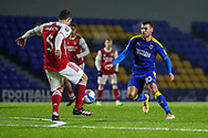 AFC Wimbledon attacker Adam Roscrow (10) battles for possession with Arsenal defender Sokratis Papastathopoulos (5) during the EFL Trophy match between AFC Wimbledon and U21 Arsenal at Plough Lane, London, United Kingdom on 8 December 2020.