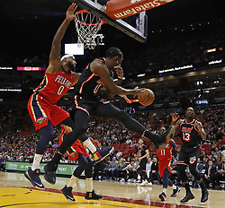 December 23, 2017 - Miami, FL, USA - The Miami Heat's Josh Richardson (0) passes to teammate Bam Adebayo (13) under the basket in the first quarter against the New Orleans Pelicans on Saturday, Dec. 23, 2017, at AmericanAirlines Arena in Miami. (Credit Image: © Al Diaz/TNS via ZUMA Wire)