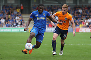 AFC Wimbledon defender Deji Oshilaja (4) battles for possession with Oldham Athletic forward Eoin Doyle (13) during the EFL Sky Bet League 1 match between AFC Wimbledon and Oldham Athletic at the Cherry Red Records Stadium, Kingston, England on 21 April 2018. Picture by Matthew Redman.