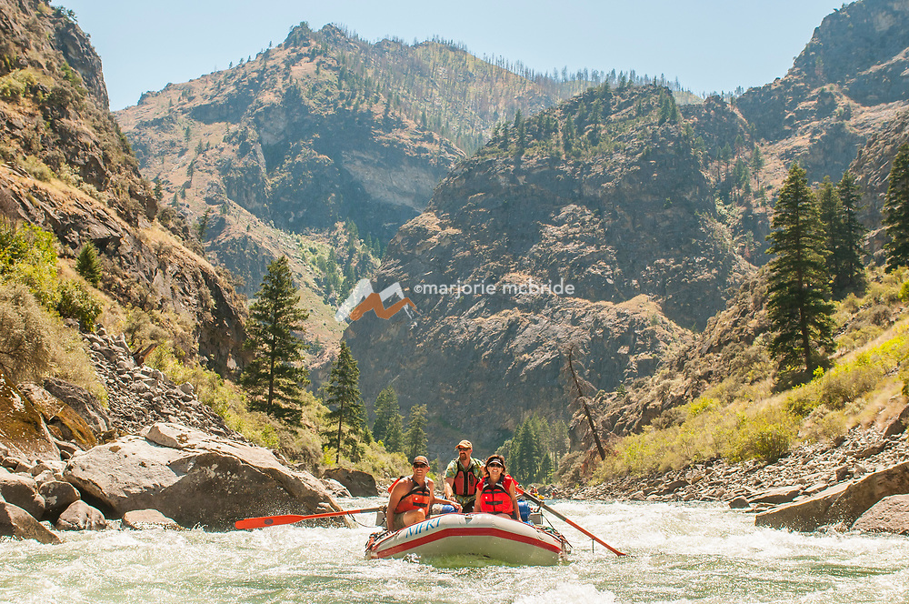Oar boat running Weber rapid in the Impassible Canyon on the Middle Fork of the Salmon River during six day rafting vacation, Idaho.