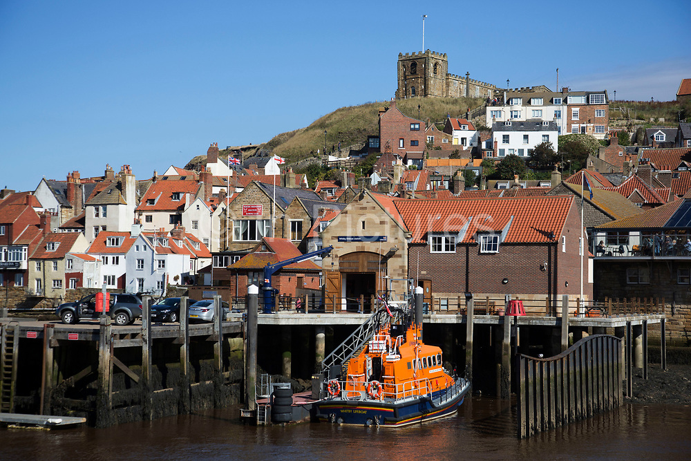 Whitby is a seaside town, port in the county of North Yorkshire, originally the North Riding. Situated on the east coast at the mouth of the River Esk. Tourism started in Whitby during the Georgian period and developed. Its attraction as a tourist destination is enhanced by its proximity to the high ground of the North York Moors, its famous abbey, and by its association with the horror novel Dracula. Yorkshire, England, UK.