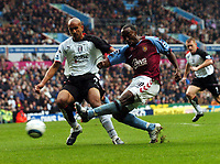 Darius Vassell Aston Villa/ Claus Jensen Fulham<br /> Aston Villa V Fulham 23/10/04<br /> The Premier League<br /> Photo Robin Parker Digitalsport