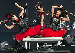 © Licensed to London News Pictures. 29/08/2015. Reading Festival, UK.  Babymetal performing at Reading Festival 2015, Day 2.  In this picture - Yuimetal (left), Sumetal (centre), Maometal (right).  Photo credit: Richard Isaac/LNP