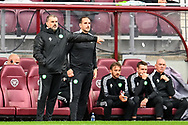 Manager of Celtic FC, Ange Postecoglou (left) and his coaching staff during the Cinch SPFL Premiership match between Heart of Midlothian FC and Celtic FC at Tynecastle Park, Edinburgh, Scotland on 31 July 2021.