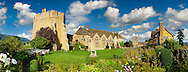 """The south tower and great hall of the  finest fortified medieval manor house in England built in the 1280s, Stokesay Castle, Shropshire, England . Stokesay Castle is one of the finest surviving fortified manor houses in England, and situated at Stokesay in Shropshire. It was largely built in its present form in the late 13th century by Laurence de Ludlow, on the earlier castle. Architecturally, Stokesay Castle is """"one of the best-preserved medieval fortified manor houses in England"""", according to historian Henry Summerson.[1] The castle comprises a walled, moated enclosure, with an entrance way through a 17th-century timber and plaster gatehouse. Inside, the courtyard faces a stone hall and solar block, protected by two stone towers. The hall features a 13th-century wooden-beamed ceiling, and 17th-century carved figures ornament the gatehouse and the solar. <br /> <br /> Visit our MEDIEVAL PHOTO COLLECTIONS for more   photos  to download or buy as prints https://funkystock.photoshelter.com/gallery-collection/Medieval-Middle-Ages-Historic-Places-Arcaeological-Sites-Pictures-Images-of/C0000B5ZA54_WD0s"""
