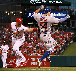 July 7, 2017 - St Louis, MO, USA - St. Louis Cardinals first baseman Luke Voit fails to tag the New York Mets' T.J. Rivera (54) after he was drawn off the bag by a wide throw from third baseman Jedd Gyorko in the fifth inning on Friday July 7, 2017, at Busch Stadium in St. Louis. The Mets won, 6-5. (Credit Image: © Chris Lee/TNS via ZUMA Wire)