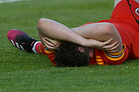 Football - 2023 UEFA U21 Championship - Qualifying - Group E - Wales vs Moldova - Steboneath Park, Llanelli<br /> <br /> Sion Spence Wales lies injured on the pitch before receiving a red card<br /> <br /> COLORSPORT/WINSTON BYNORTH