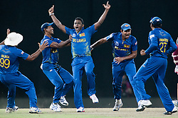 © Licensed to London News Pictures. 07/10/2012. Sri Lankan Ajantha Mendis & teammates celebrate after getting the prized wicket of Chris Gayle during the World T20 Cricket Mens Final match between Sri Lanka Vs West Indies at the R Premadasa International Cricket Stadium, Colombo. Photo credit : Asanka Brendon Ratnayake/LNP