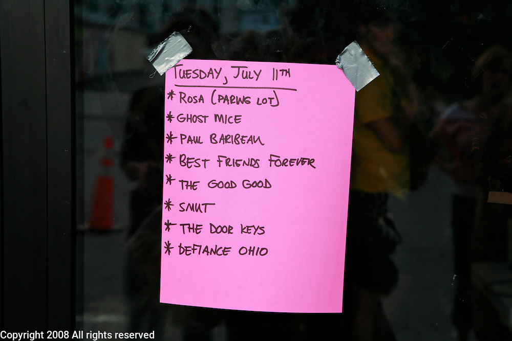 The play list for July 11, 2006 hangs on the door of Rhino's during the Plan-It-X Festival.