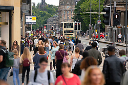 Edinburgh, Scotland, UK. 24 July, 2020. View along busy Princes Street with large numbers of people out shopping during sales. Iain Masterton/Alamy Live News