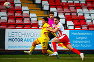 Josh Gordon of Walsall about to be wiped out by Joe Martin of Stevenage during the EFL Sky Bet League 2 match between Stevenage and Walsall at the Lamex Stadium, Stevenage, England on 20 February 2021.